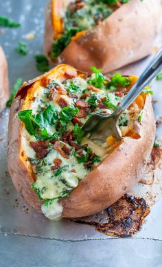 These easy Cheesy Kale Stuffed Sweet Potatoes are a tasty way to pile on those veggies! They're gloriously gluten-free and great as a side or a main course!