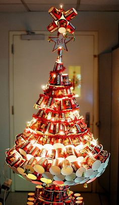 Cup Christmas Tree - had a get together and used lots of cups? Rinse them out and make a tree.  How clever! I may just do this with an old one that's ready for throw out. #ReduceReuseRecycle