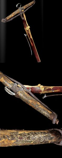 """A very fine and rare gothic crossbow, Southern Germany. The composite bow is covered with parchment decorated in monochrome to simulate fish skin or snakeskin. Part of the panel represents"""" Eve holding the fruit of the tree of knowledge"""". Dated cross bows before the 16th century are extremely rare, ca 1475."""