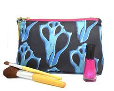 MARINE MOLLUSK Makeup Bag   Navy & Blue with Pink YKK zipper   A Portion of Proceeds go to Charity  This is a beautiful and functional bag perfect for jewelry, make up, craft supplies or anything you want to keep organized. –––––––––––––––––––––––––––––––––––––––––––––––––––––––––– ABOUT US: Our mission is to surround yourself with Earth's unique and irreplaceable treasures. We believe nature is the greatest designer and source of limitless inspiration. Through the lens of our cameras, we…