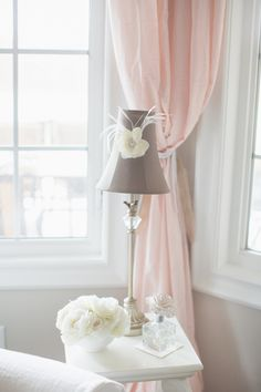 Soft flowy curtains, pretty walls and end table - shabby chic nursery sweetness!