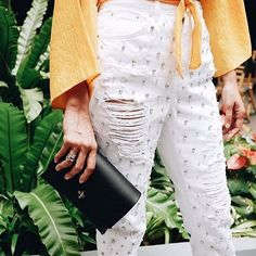 Stand-out denim that's pretty much compliments guaranteed. We're in love with these white embellished Mom jeans.