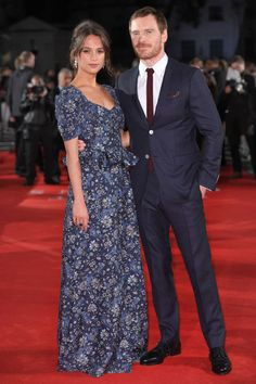 20 October For the London premiere of The Light Between Oceans, Alicia Vikander wore custom Louis Vuitton as she posed with her co-star and boyfriend Michael Fassbender who looked sharp in a navy suit.