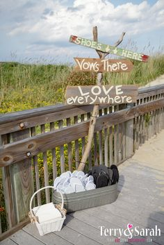 Flip-flop station on the way to the beach.   Photo by Terry and Sarah Photography www.engagingeventsbox.com #engagingeventsobx #beachwedding