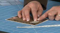 How To Align Brads Perfectly Every Time by Scrapbook Expo. Diana shares some simple tricks to use when aligning brads, pearls or other small embellishments.