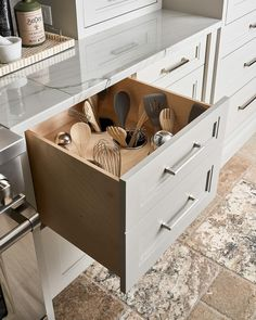 Custom kitchen utensils in a gray drawer organize the space finished with gray quartzite countertops and stainless steel appliances. White Shaker Cabinets, Grey Kitchen Cabinets, Kitchen Drawers, Kitchen Utensil Storage, Kitchen Utensil Organization, Kitchen Organizers, Organization Ideas, Gold Kitchen Utensils, Organize Kitchen Utensils