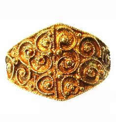 Anglo-Saxon Filigree Ring from the Leeds Hoard – A very attractive and complete ring with filigree decoration, in excellent condition.  Two panels of six filigree scrolls are each separated by a fine filigree line bisecting the bezel.  Gold pellets sit in the centre of each scroll and in some of the angles between them.