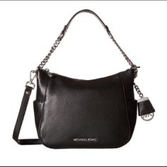 NWT Michael Kors Chandler Bag!! You'll be sure to turn heads with the stylish and glamorous Chandler Medium Convertible Shoulder Bag!  Made of pebbled leather. Top-zip closure. Leather and chain-linked shoulder strap. Detachable, adjustable crossbody strap. Signature logo hardware. Bag charm accent. Two exterior slip pockets. Custom woven lining. Interior features zip pocket and multifunctional pockets. Measurements: Bottom Width: 9 1⁄4 in Depth: 3 1⁄4 in Height: 7 1⁄2 in Strap Length: 47 in…