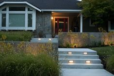 Front Yard Retreat modern landscape i like the lights built into the stairs