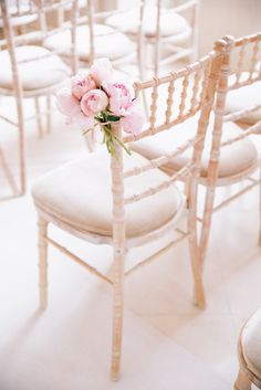Peony Power: A touch of elegance to these beautiful aisle chairs. #chairdecor #peonies #weddingseating See more...@intimatewedding
