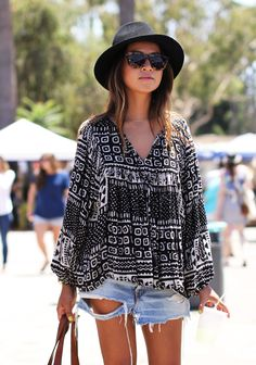 Black & white is always classic, done in a tribal graphic so chic! A loose peasant cut blouse in cotton is so comfy worn with deconstructed jean cut-offs.