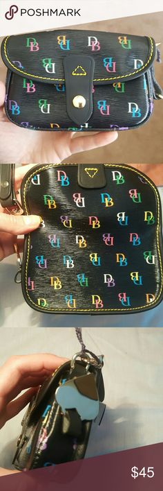 """Final sale NEW dooney & bourke multi flap wristlet NWT. Was intended as a gift, not my style ! Simple and stylish. Signature fabric lends sophistication to this functional wristlet. A detachable wrist strap, and a heart logo complete the luxe look. Snap closure Measures 1-1/2""""W x 6""""L x 4""""D with a 6-1/2""""L strap drop Plastic-coated cotton body; leather trim Smoke free pet free home Dooney & Bourke Bags Clutches & Wristlets"""