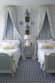~Pretty Blue & White Guest Room by Cathy Kincaid.  I like what they did with the curtains/wallpaper