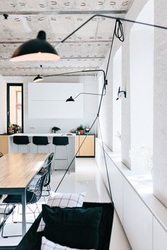 All white with black details and wired chairs//