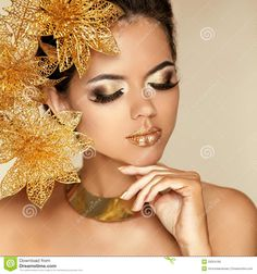 Model Girl Face With Gold Make-up And Accessories Stock Photo ...