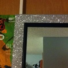 Bought a plain door mirror and covered the frame with glitter tape from michaels for our dorm