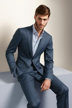 Business casual can be achieved by simply removing your tie.  It makes a very professional look slightly more relaxed.