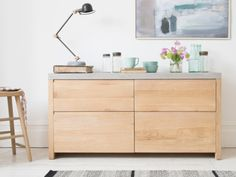 The winning combo of natural oak and a concrete-look top help this sturdy sideboard fit right into both country-ish and modern-ish homes. Walk this way...
