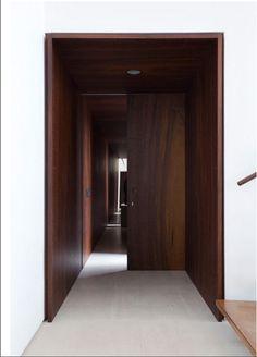 Wooden door frame and corridor.