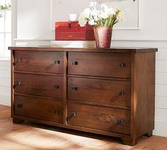 A deep mahogany stain highlights the natural distressing of our Sumatra Extra-Wide Dresser's wood, hand-chosen for its unique character. Rustically beautiful knots, burls, whorls and dings add to the inherent beauty of this piece, which is d…