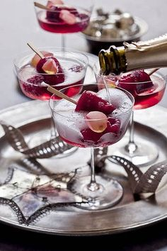 Pour champagne over a raspberry popsicle and garnish with raspberries...holiday magic...simple, elegant.