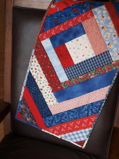 Quilted table runner with strips of fabric.  It is fast and easy with the step by step guide provided.