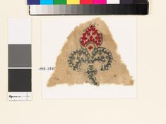 Textile fragment with fleur-de-lys and linked crossesfront | Near East 10th - 15th century | cotton, embroidered with red and blue silk
