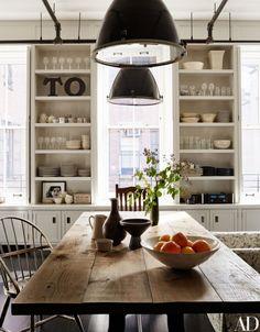kitchen, farm table, antique table, black pendant lights, open shelves, shelves between windows
