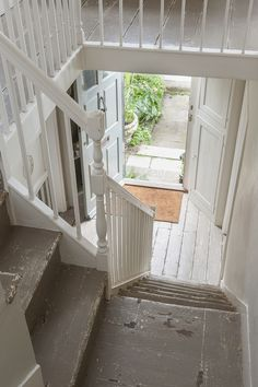 cream coloured walls and grey distressed stairs