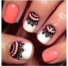 Orange, black, and white nails