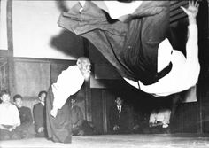 O'Sensei throwing Hiroshi Tada,  used for the  cover of the Kisshomaru Ueshiba's first published book on aikido, c. 1956