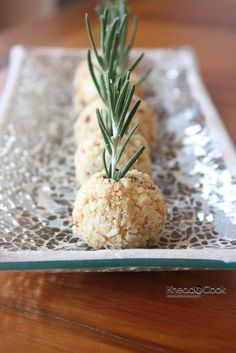 These cheese balls are as adorable as they are delicious. Bonus: they're super easy to make, too! Combine gorgonzola, cream cheese, rosemary, white wine, and seasoning, then form into balls. Roll in ground almonds, and top with rosemary springs.