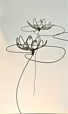 Floating water lily wire Sculptures by Jessica Bohus Tattoos To Cover Scars, Wire Wall Art, Floating Water, Wire Drawing, Wire Sculptures, Artist Work, Wine Design, Wire Crafts, Water Lilies