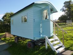Huntstile Shepherd's Hut Trailer, Somerset. Sleeps up to four - 2 adults and 2 children. It has a table and chairs, a 6ft wide bed, plus the facility for two bench bunks http://www.organicholidays.co.uk/at/1980.htm