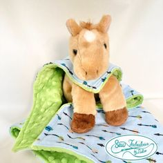 """Let this unique lovey friend be your new tool to help calm your little one!  Soft flannel and minky blanket that becomes a custom-fit """"cape""""  Blanket is removable and washable for easy care!"""