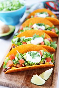 Three Bean Tacos Recipe on twopeasandtheirpod.com You can have these delicious tacos on your dinner table in 20 minutes! #tacos #dinner #vegetarian