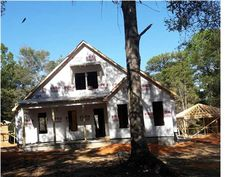 """Under construction. Gold fortified. Modern coastal cottage by mcelmurry homes, specifically designed for this level cul-de-sac lot in walking distance to downtown fairhope.  With almost 300 sq ft of covered front & back porches there is space for the outdoor lover. Each porch has custom columns, wood ceilings, finished floors & custom lighting. """"Fairhope meets farmhouse"""" cottage flair dressed with lighting, designer finishes, custom trim-work ..."""