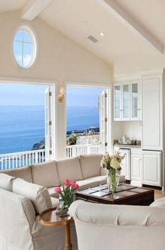We Home Design — Beach house sitting room with a balcony and an. House Design, House, Dream Beach Houses, Beach House Interior, Beautiful Homes, Beach Cottages, House Interior, Coastal Living Rooms, Vacation Home