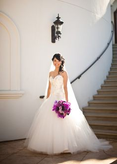 absolutely stunning the dress and the flowers against it :)