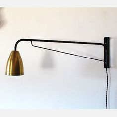Items similar to Black powder coated swiveling wall lamp with brass shade on Etsy Lamp Light, Light Up, Gold Light, I Love Lamp, Brass Lamp, Modern Industrial, Industrial Design, Wall Sconces, Wall Lamps