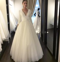 "Viktor & Rolf Fall 2018 Wedding Collection featuring style ""Iced Flower Plisse Gown"" sophisticated and austere voluminous plissé tulle ballgown with a low V-neck three-quarter sleeves bodice and wide trompe l'ceil belt accented with a small bouquet of iced flowers handcrafted out of 3D plexiglass and crystals! @viktorandrolf #viktorandrolf #viktorandrolfcouture #viktorandrolfbridal #couture #newcollection #debutcollection #viktorandrolfbridal #flowerbomb #plexiglass #ballgown #tulle #wedding…"