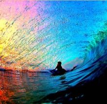 Beautiful picture of the sunset through a wave.