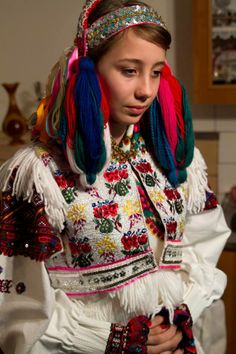 Europe | Portrait of a bride wearing a traditional wedding dress and bridal headdress, Polomka, Slovakia #wedding #embroidery #tassel