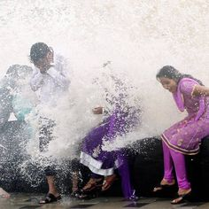 People enjoy high tide waves during monsoon rains on the Arabian Sea coast in Mumbai - been there and done that too :)) http://itz-my.com