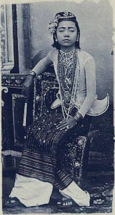 """Portrait of a Burmese entertainer taken at the Johannes & Co. Studio on """"C Road"""" in Mandalay c. 1895."""
