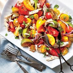 Serve this fresh summer salad with plenty of crusty bread to soak up the flavorful tomato juices.