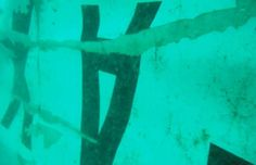 In this undated underwater photo released by Indonesia's National Search And Rescue Agency (BASARNAS) on Wednesday, Jan. 7, 2015, the part of the wreckage that BASARNAS identified as of the ill-fated AirAsia Flight 8501 is seen in the waters of the Java Sea, Indonesia.
