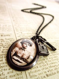 Steampunk Lady Necklace - Victorian Tattoo Circus Lady Cabochon Antique Black Brass Mourning Pendant. £ 25.00, via Etsy.