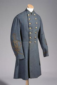 Grey wool Confederate Infantry uniform with gold braid on sleeves, Lt. Col. stars on collar (1 missing), and buttons with US staff eagle and shield, collar lined with green velvet.  North CarolinaMuseumof History