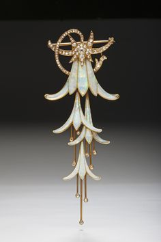 Breathtaking creation by Georges Fouquet depicting the delicate blooms of a trailing fuchsia flower in gold, opals, and diamonds  (1902-1903).  Georges Fouquet, a famous French jeweler, is best known for his collaboration with artist Alphonse Mucha, creating such spectacular art nouveau pieces for the 1900 World Fair in Paris.